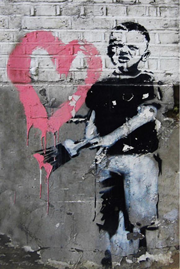 Boy-Painting-Pink-Heart-by-Banksy